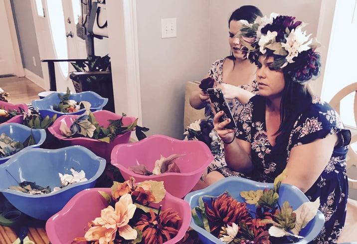 setup for a fetes de fleurs flower crown making party